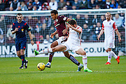 Ross County Midfielder Stewart Murdoch and Hearts FC Forward Osman Sow attack the ball during the Ladbrokes Scottish Premiership match between Heart of Midlothian and Ross County at Tynecastle Stadium, Gorgie, Scotland on 24 October 2015. Photo by Craig McAllister.