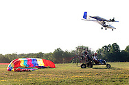 An ultralight pilot flies over Randall Airport in Middletown, N.Y., while another ultralight gets ready to take off..July 2, 2005.