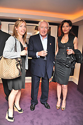 Left to right, EMMA DIXON, SIR JOHN BECKWITH and OZLEM ONAL at a private view of an exhibition of photographs by Mike Figgis entitled 'Kate & Other Women' held at The Little Black Gallery, 13 A Park Walk, London SW10 on 22nd June 2011.