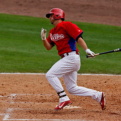 Feb 26, 2013; Clearwater, FL, USA; Philadelphia Phillies second baseman Kevin Frandsen (28) hits a double scoring shortstop Jimmy Rollins (not pictured) during the bottom of the sixth inning of a spring training game against the New York Yankees at Bright House Field. Mandatory Credit: Derick E. Hingle-USA TODAY Sports