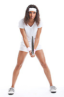 Portrait of sporty young woman with tennis racket against white background