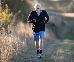 © Licensed to London News Pictures. 01/10/2018. Thame, UK. Boris Johnson runs near his Oxfordshire home. The former foreign secretary is due to attend Conservative Party Conference this week. Photo credit: Peter Macdiarmid/LNP