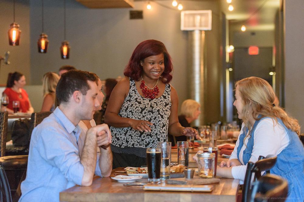 Felicia Corbett serves tables during dinner at Louvino, Thursday, Aug. 18, 2016. (Photo by Brian Bohannon)