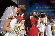 Pro-Putin Nashi youths participate in a group wedding during a summer camp on Lake Seliger in Russia. The yearly camp, organised by the nationalistic group, trains youth in political activism.