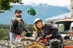 The town of Haines, in southeast Alaska, celebrates the Fourth of July with a parade, picnic, and other activities. Typically in parades, participants through out candy to the crowd. However in this parade, a local group of miners opted to toss plastic gold mining pans to the parade watchers who lined the parade route. <br /> <br /> In the past, mining in the Chilkat Valley has been limited to small placer-type gold mines. Recently, Constantine Metal Resources along with investment partner Dowa Metals & Mining Co., Ltd. of Japan is exploring a potential site for a copper, zinc, gold and silver mine in the valley above Glacier Creek. If approved and developed, the mine, near Haines, Alaska would be an underground mine. Besides the actual ore deposits, having the nearby highway access for transporting ore to the deepwater port at Haines is also attractive to Constantine.<br /> <br /> Support for a large scale mine such as the Constantine project is divided among residents of Haines, a small community in Southeast Alaska 75 miles northwest of Juneau. The community's needed economic boost from jobs, development and other mine support that a large-scale mine brings is tempting to some. To others, anything that might put the salmon spawning and rearing habitat and watershed resources at risk is simply unimaginable and unacceptable. Of particular concern is copper and other heavy metals in mine waste leaching into the Klehini River and the Chilkat River 14 miles downstream. Copper and heavy metals are toxic to salmon and bald eagles.<br /> <br /> The Chilkat River chum salmon are the primary food source for one of the largest gatherings of bald eagles in the world. Each fall, bald eagles congregate in the Alaska Chilkat Bald Eagle Preserve, located only three miles downriver from the area of current exploration.