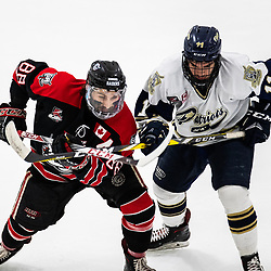 TORONTO, ON - APR 10, 2018: Ontario Junior Hockey League, South West Conference Championship Series. Game seven of the best of seven series between the Georgetown Raiders and the Toronto Patriots, Andrew Court #88 of the Georgetown Raiders and Brett Bannister #11 of the Toronto Patriots battle for position during the first period.<br /> (Photo by Kevin Raposo / OJHL Images)