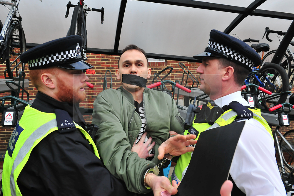 © Licensed to London News Pictures.04/11/2017.<br /> BROMLEY, UK.<br /> Anti fascist protester being detained by police. <br /> Britain First hold a Persecuted Patriots Rally outside Bromley Police Station, Bromley South.Party Leader Paul Golding and his deputy Jayda Fransen have to sign on bail every Saturday 2pm at Bromley Police station.<br /> Photo credit: Grant Falvey/LNP
