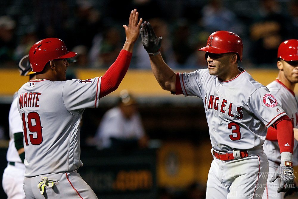 OAKLAND, CA - APRIL 04:  Danny Espinosa #3 of the Los Angeles Angels of Anaheim is congratulated by Jefry Marte #19 after hitting a three run home run against the Oakland Athletics during the ninth inning at the Oakland Coliseum on April 4, 2017 in Oakland, California. The Los Angeles Angels of Anaheim defeated the Oakland Athletics 7-6. (Photo by Jason O. Watson/Getty Images) *** Local Caption *** Danny Espinosa; Jefry Marte