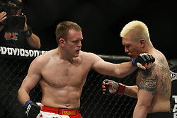 Apr 18, 2009; Montreal, Quebec, CAN; Ryo Chonan (black) and TJ Grant (red/white) battle during their welterweight bout at UFC 87: Redemption at the Bell Centre in Montreal, Canada.  Grant won via split decision.
