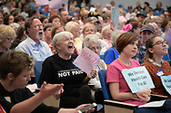 Maggie MacDonald (C), 72, reacts to an answer from U.S. Representative Ted Yoho (R-FL) about Planned Parenthood during a town hall meeting in Gainesville, Florida, U.S., April 10, 2017.  REUTERS/Phelan Ebenhack