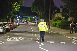 © Licensed to London News Pictures. 26/06/2020. London, UK. A police officer walks towards the cordon on Du Cane Road. A person has been stabbed on Du Cane Road in East Acton on Thursday 25th June 2020. A cordon closed off a large section of the road underneath a railway bridge where two vehicles remained. Photo credit: Peter Manning/LNP
