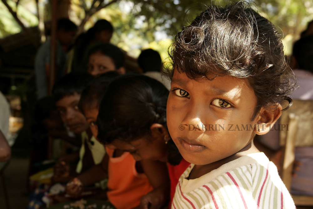 Children homeless since the tsunami wait to have lunch at a Buddhist temple in Mirissa on the south coast of Sri Lanka on January 15, 2005..Photo by Darrin Zammit Lupi