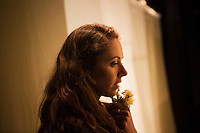 SLIEMA, MALTA - 8 FEBRUARY 2016: Actress Phoebe Fildes waits backstage before entering the scene of touring Hamlet, performed by the Shakespeare's Globe theatre company, at the Salesian Theatre in Sliema, Malta, on February 8th 2016.<br /> <br /> The touring Hamlet, performed by the Shakespeare's Globe theatre company, is part of the Globe to Globe tour that set off in April 2014 (on the 450th anniversary of Shakespeare's birth) with the ambitious intention of visiting every country in the world over 2 years. The crew is composed of a total of sixteen men and women: four stage managers and twelve twelve actors  actors perform over two dozen parts on a stripped-down wooden stage. So far Hamlet has been performed in over 150 countries, to more than 100,000 people and travelled over 150,000 miles. The tour was granted UNESCO patronage for its engagement with local communities and its promotion of cultural education. Hamlet was also played for many dsiplaced people around the world. It was performed in the Zaatari camp on the border between Syria and Jordan, for Central African Republic refugees in Cameroon, and for Yemeni people in Djibouti. On February 3rd it was performed to about 300 refugees in Calais at the camp known as the Jungle.