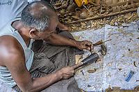 At a wood carving factory in Mandalay, Burma.