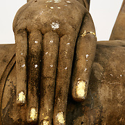 Buddhas hand at Wat Mahathat in Sukhothai. The Sukhothai kingdom was an early Thai kingdom in north central Thailand. It existed from during the 13, 14, 15th centuries The.old capital is in ruins and is a Historical Park..View from Feb, 2007.