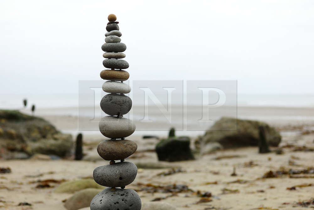 © Licensed to London News Pictures. <br /> 28/09/2014. <br /> <br /> Sandsend, United Kingdom<br /> <br /> Beach artists and stone balancers take part in a sand art event held on the beach at Sandsend near Whitby. The event which took place as the tide dropped was short lived and was lost forever once the tide came back in.<br /> <br /> Photo credit : Ian Forsyth/LNP