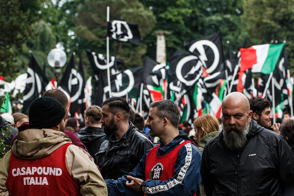 23.5.2015, Gorizia, Italy<br /> <br /> Brugi - look of Death <br /> <br /> Rally of neofascists from whole Italy in Gorica at 100. anniversary of entry of Italy into the 1st World War organised by fascistic movement Casa Pound. All fascist groups brought soil from different parts of Italy to celebrate 1. WW. They marched in silence, but everyone who was present at rally could feel dim and creepy atmosphere.<br />  After the end of 1. World War Italy litteraly enslaved, tortured and changed names of Slovenian people to Italian names in Primorska region. On  July 13. 1920 Italian fascists burned down Slovenian National home in Trieste and about 21 different buildings, offices, apartments, banks, printing offices, warehouses and pubs. Interresting was that, that official government didn`t arrest none of raging demonstrants. After that fascists(from 1920 to 1941 killed almost 40 000 Slovenes in Primorska region. Italy even today denies genocide over Slovene population in Primorska region and tries to hide its role during 2. World War by silence about this part of history in their history books. That`s the main reason why in Italy young people again embrace fascits ideology.
