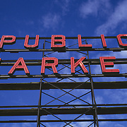 Red Public Market Sign Against Blue Sky; Pike Place Market; Seattle, Washington