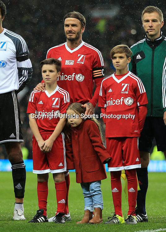 14th November 2015 - Charity Football - UNICEF Match For Children - GB & Ireland XI v World XI - David Beckham of GB stands with his sons Cruz (L) and Romeo (R) and daughter Harper (C) - Photo: Simon Stacpoole / Offside.