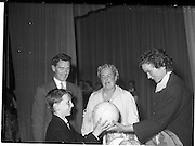 22/05/1959<br /> 05/22/1959<br /> 22 May 1959<br /> Gael Linn Singing Competition at the Dominican Convent, Dun Laoghaire.Maureen Cusack, actress, wife of Cyril Cusack (left) presenting  1st prize (under 11) to 9 year old Liam &Oacute; Finnan, St Marys, Lower Mountain, Dun Laoghaire. Also in picture is Diarmuid &Oacute; Broin, Gael Linn National Organiser.