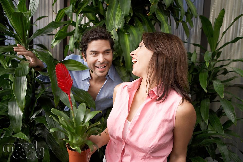 Playful Couple at a Plant Nursery