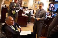 12 Jul 2012 --- Senators Charles Schumer and Al Franken meeting before a press conference --- Image by © Owen Franken/Corbis