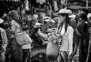 Myanmar. Aungban market - flowers and baskets.
