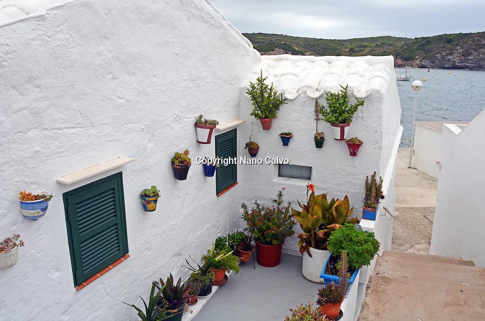 Rainy day in Es Grau, beautiful fishing village in Menorca