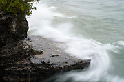 Wind-blown waves at Cave Point County Park, Door County, Wisconsin Waves breaking on the Lake Michigan shore at Cave Point County Park, Door County, Wisconsin