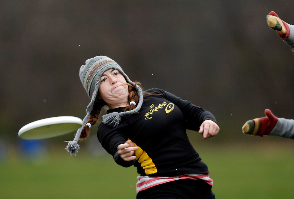 With temperatures in the 30s, high winds and snow flurries, Saturday's ultimate Frisbee tournament was anything but hospitable. For Beth Aubuchon, however, it could have been a whole lot worse.<br /> <br /> This is the biggest year yet for the tournament. Twenty-two women's teams from around the country are spread out over Hinkson and Epple fields. Cheers echo off the frozen landscape.<br /> <br /> &quot;We're more competitive than people realize,&quot; Beth says. &quot;You run hard, you throw hard.&quot;<br /> <br /> So far this tournament, nobody on her team, the MUchachas, has been injured. Knee injuries are the most common, but last year Beth broke a finger. Her pinkie still sticks out at an uncomfortable angle.<br /> <br /> &quot;This is truly a team sport,&quot; Beth says. &quot;You have to rely on each other to score. One person can't win the game.&quot;<br /> <br /> After each catch, a player has 10 seconds to throw to a teammate and can only pivot as a defender tries to block the throw. On the field, Beth moves around making passes and catches with hands bare to the freezing temperatures. It's too hard to grip with gloves on.<br /> <br /> On the sidelines, the team huddles under blankets. &quot;I love my Frisbee family,&quot; Beth says, hugging a teammate.<br /> <br /> Their next opponent is late to the field. Beth hangs out on the sidelines as seven of her teammates line up in the end zone to begin assessing points. For each five minutes the other team doesn't show, the MUchachas get a free point. These are the easiest points they've scored all weekend.<br /> <br /> They shiver in the high wind. Eating bananas and granola bars, they laugh and fidget to stay warm.<br /> <br /> &quot;Have we scored yet?&quot;<br /> <br /> Beth checks the time. &quot;Not yet!&quot; she yells back.<br /> <br /> &quot;Can I get a sub?&quot; comes the reply.<br /> <br /> &quot;OK,&quot; Beth says, &quot;but I'm bringing the Coco Puffs.&quot;