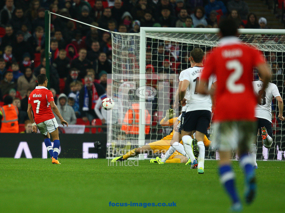 Picture by Rob Fisher/Focus Images Ltd +44 7450 945824<br /> 15/11/2013<br /> Alexis Sanchez of Chile scores their second goal during the Friendly match at Wembley Stadium, London.