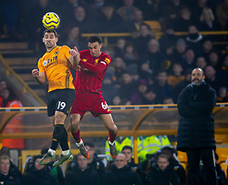 WOLVERHAMPTON, ENGLAND - Thursday, January 23, 2020: Liverpool's Trent Alexander-Arnold (R) challenges for a header with Wolverhampton Wanderers' Jonathan Castro Otto 'Jonny' during the FA Premier League match between Wolverhampton Wanderers FC and Liverpool FC at Molineux Stadium. (Pic by David Rawcliffe/Propaganda)