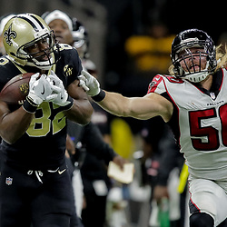 Nov 22, 2018; New Orleans, LA, USA; New Orleans Saints tight end Benjamin Watson (82) catches a pass over Atlanta Falcons defensive end Brooks Reed (50) during the third quarter at the Mercedes-Benz Superdome. Mandatory Credit: Derick E. Hingle-USA TODAY Sports