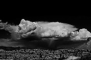 A black and white picture of a storm cloud and rain in the Arizona desert. Missoula Photographer