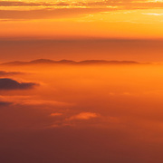 The sun rises over the East Bay hills, as seen from the summit of Mount Tamalpais in the San Francisco Bay Area.