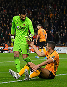 Rui Patricio (11) of Wolverhampton Wanderers helps Conor Coady (16) of Wolverhampton Wanderers up after the Coady denied Ryan Fraser (24) of AFC Bournemouth at shot at goal during the Premier League match between Bournemouth and Wolverhampton Wanderers at the Vitality Stadium, Bournemouth, England on 23 November 2019.