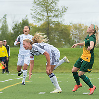 2nd year defender Cassie Longmuir (18) of the Regina Cougars gets physical during the Women's Soccer home game on September 11 at U of R Field. Credit: Arthur Ward/Arthur Images