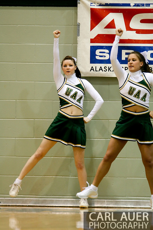 1/13/2006: UAA Cheerleaders cheer as Alaska Anchorage gets a comeback victory over Northwest Nazarene, 60-57, in men?s basketball action at the Wells Fargo Sports Complex on Saturday.
