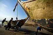 Fishermen pull in their boat onto the beach after returning from sea in Cape Coast, roughly 120km west of Ghana's capital Accra on Thursday April 9, 2009..