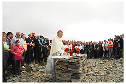 The Pilgrim's prayer . Archbishop of Tuam Michael Neary celebrating mass on the summit of Croagh Patrick on reek sunday. The 11am mass was broadcast live on RTE and on the internet...Pic Conor McKeown.