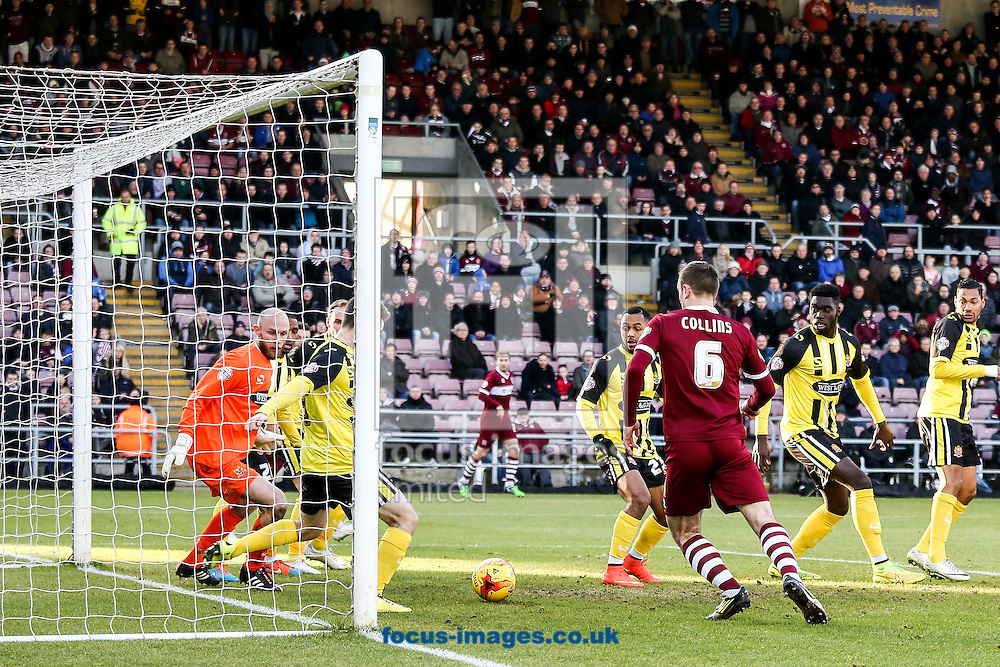 Dagenham clear a shot off their goal line during the Sky Bet League 2 match at Sixfields Stadium, Northampton<br /> Picture by Andy Kearns/Focus Images Ltd 0781 864 4264<br /> 17/01/2015
