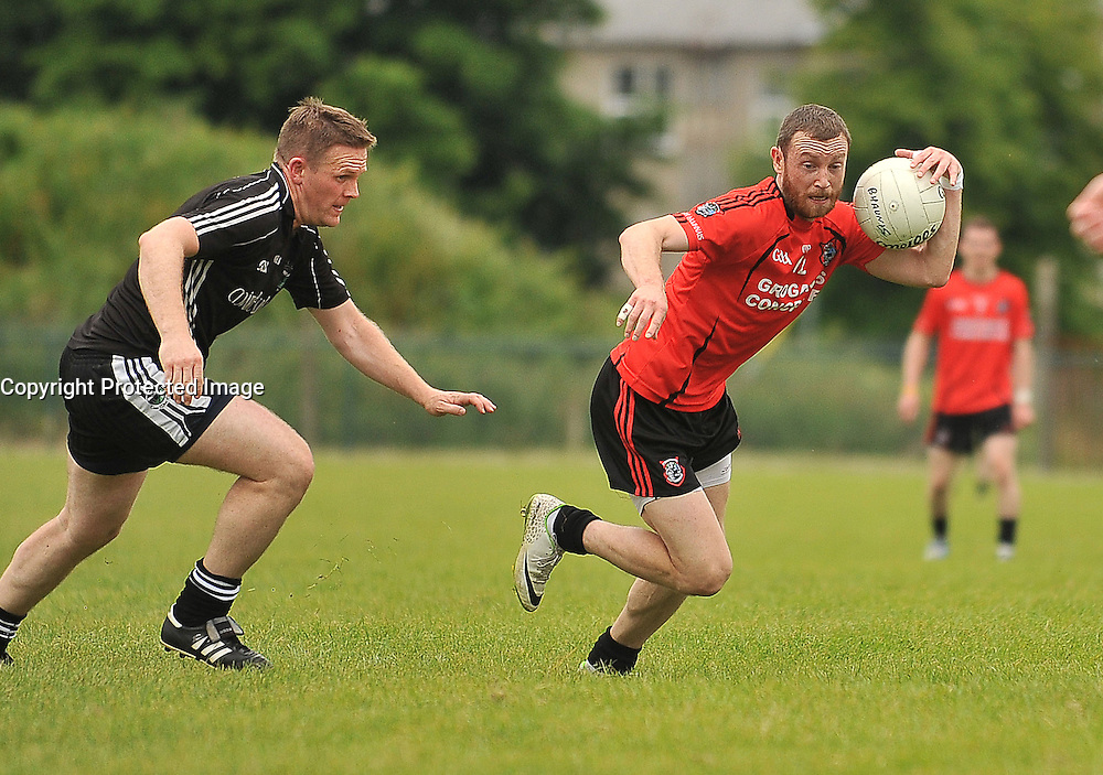 Ballyhaunis's Keith Higgins gets away from Tourmakeady's Brendan Prendergast during their Intermediate Championship clash on sunday.<br /> Pic Conor McKeown