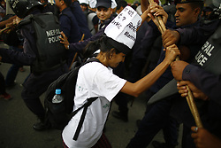 August 15, 2017 - Kathmandu, Nepal - An activist clashes with riot police during a demonstration to save the life of Dr. Govinda KC who is in hunger strike for the last 23 days for the 11th time demanding reforms in medical education sector in Kathmandu, Nepal. (Credit Image: © Skanda Gautam via ZUMA Wire)