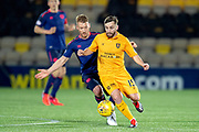 Steven Lawless (#15) of Livingston FC shields the ball from Oliver Bozanic (#7) of Heart of Midlothian during the Ladbrokes Scottish Premiership match between Livingston FC and Heart of Midlothian FC at the Tony Macaroni Arena, Livingston, Scotland on 14 December 2018.