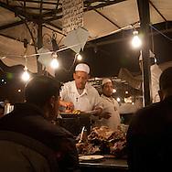 Morocco, Marrakech , outdoor restaurant in Jama Al Fnaa square in the old city medina  Marrakech  /  les restaurants de la Place Jema al Fnaa, dans la medina de la vieille ville  Marrakech  Maroc