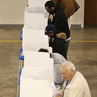 Area voters cast their ballots Tuesday morning at the Bissell Baptist Church precinct.