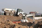 Dump truck and excavator at the construction site of Expo 2015, Rho, June 2014. &copy; Carlo Cerchioli<br /> <br /> Camion ribaltabile e escavatore per il movimento terra al cantiere di Expo 2015, Rho, giugno 2014.