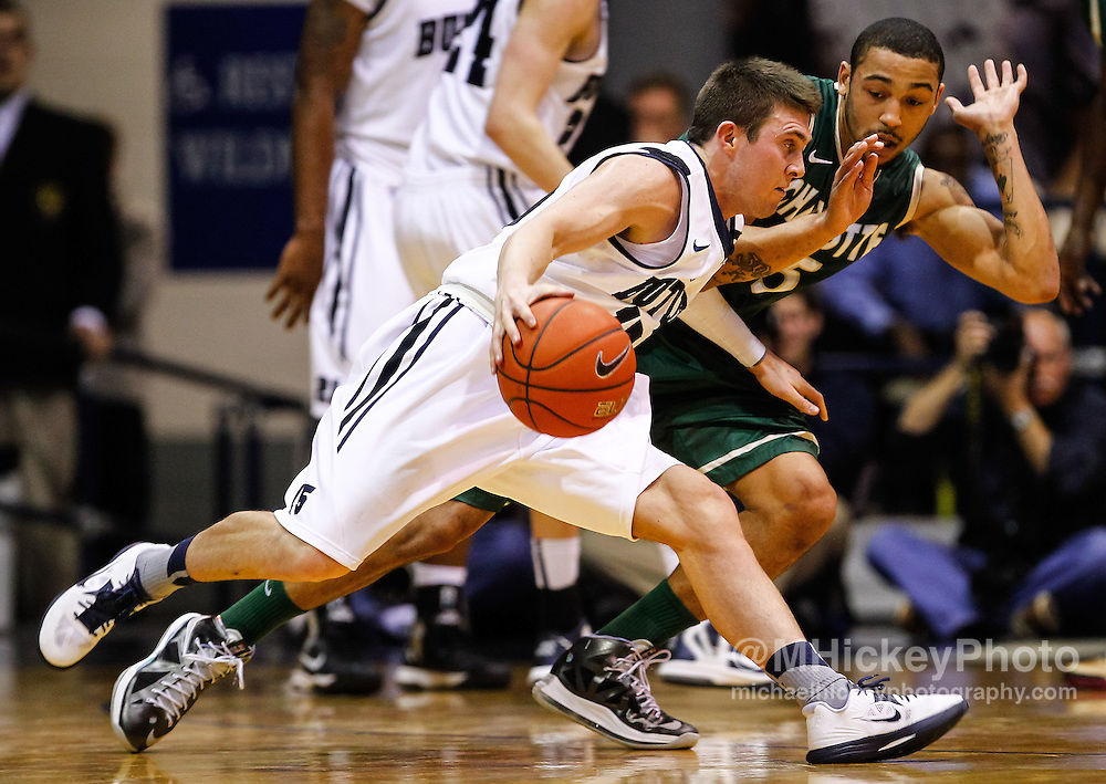 INDIANAPOLIS, IN - FEBRUARY 13: Rotnei Clarke #15 of the Butler Bulldogs dribbles the ball against Pierria Henry #15 of the Charlotte 49ers at Hinkle Fieldhouse on February 13, 2013 in Indianapolis, Indiana. Charlotte defeated Butler 71-67. (Photo by Michael Hickey/Getty Images) *** Local Caption *** Rotnei Clarke; Pierria Henry