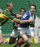 24/05/2002 (Friday).Sport -Rugby Union - London Sevens.South Africa vs France.SA Anton Pitout (L) and Paul Treu - France Jerome daret?[Mandatory Credit, Peter Spurier/ Intersport Images].