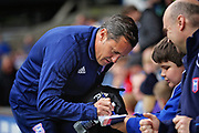 Ipswich Town Manager Paul Hurst   signing an autograph for a young fan before the EFL Sky Bet Championship match between Ipswich Town and Bolton Wanderers at Portman Road, Ipswich, England on 22 September 2018.